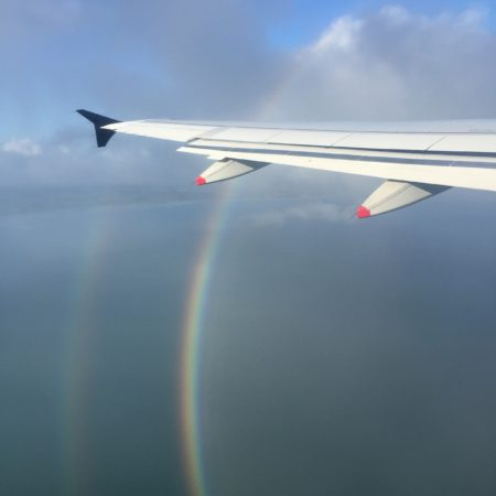 Aeroplane wing and rainbow
